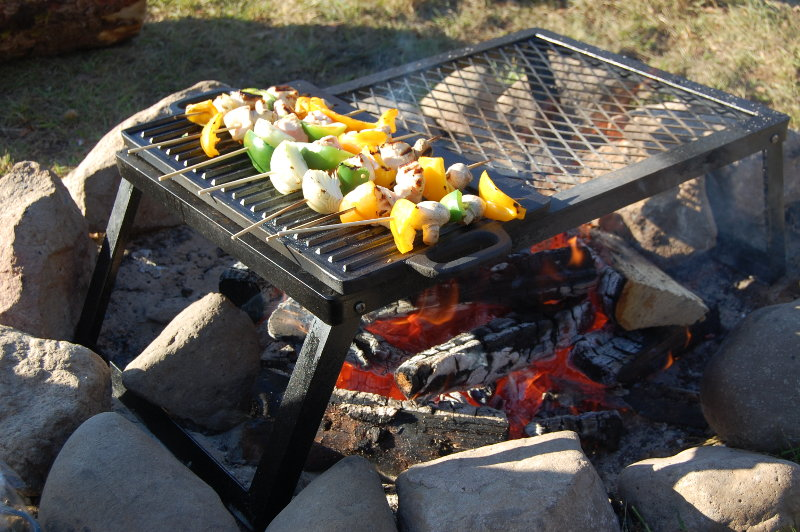 cooking using griddle over outdoor fire pit