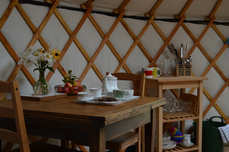 there is ample dining space within the yurt